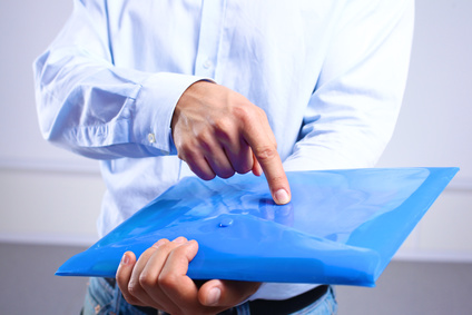 businessman showing a folder with important documents.